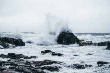 sea waves hitting rocks